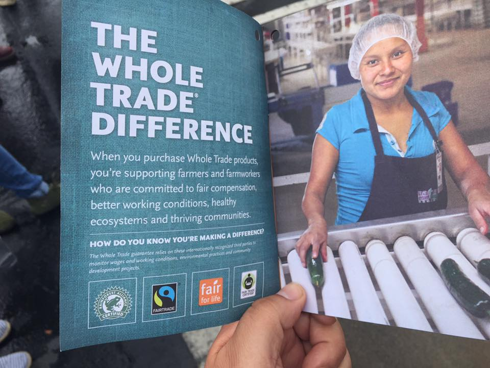 "Photo by Xolotl Edgar Franx. May 28, 2016. A manager at the new Whole Foods Market in Bellingham, WA gave supporters of Families United for Justice and the international Driscoll's Boycott a booklet with information on ""The Whole Trade Difference"" when they were holding signs and distributing flyers in front of the store. Original photo caption by Xolotl Edgar Franx: More ""fair trade"" labels, no justice for farm workers."